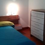 Спальня с двухспальной кроватью в таунхауз El Madronal