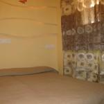 Кровать в спальне Парк Рояль 1
